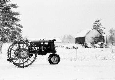 Vintage F12 Steel Wheeled Tractor in Snow